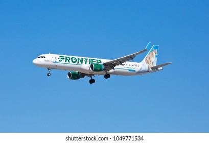 Chicago, USA - March 19, 2018: Frontier Airlines Airbus A320 with the Cougar livery approaching O'Hare International Airport.
