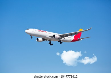 Chicago, USA - March 19, 2018: An Iberia Airbus 330 landing at O'Hare International Airport. Iberia is the flag carrier and the largest airline of Spain.