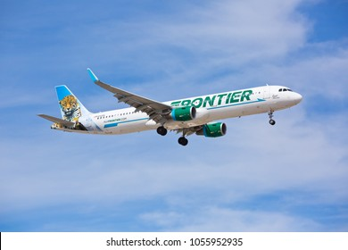 Chicago, USA - March 27, 2018: Frontier Airlines Airbus A320 with the Jaguar livery approaching O'Hare International Airport.