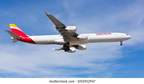 Chicago, USA - March 27, 2018: An Iberia Airbus 340 landing at O'Hare International Airport. Iberia is the flag carrier and the largest airline of Spain.