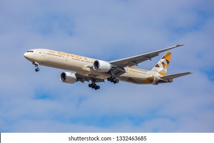 Chicago, USA - March 7, 2019: Etihad Airways Boeing 777-300ER wide-body passenger plane landing at O'Hare International Airport.