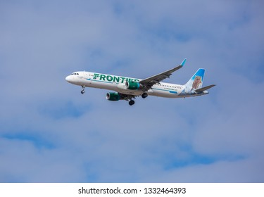 Chicago, USA - March 7, 2019: Frontier Airlines Airbus A321 with the Pygmy Owl livery approaching O'Hare International Airport.