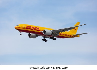 Chicago, USA - May 13, 2020: A DHL Boeing 777 aircraft landing at O'Hare International Airport. DHL is Europe's largest cargo only airline and owned by Deutsche Post.