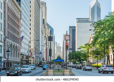 Chicago, USA - May 30, 2016: Divided street with traffic on South Michigan Avenue in downtown with cars and skyscrapers