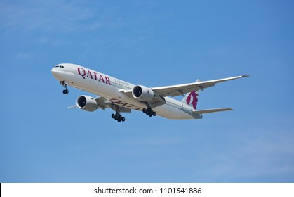 Chicago, USA - May 30, 2018: A Boeing 777-300ER aircraft of Qatar Airways landing at the O'Hare International Airport. Qatar Airways is the national airline of Qatar, based in Doha.