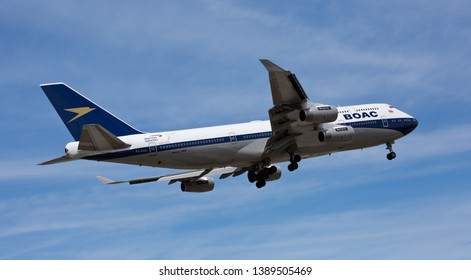 Chicago, USA - May 5, 2019: A British Airways Boeing 747 landing at O'Hare International Airport. British Airways takes a step back in time to welcome Boeing 747-400 with the BOAC livery.