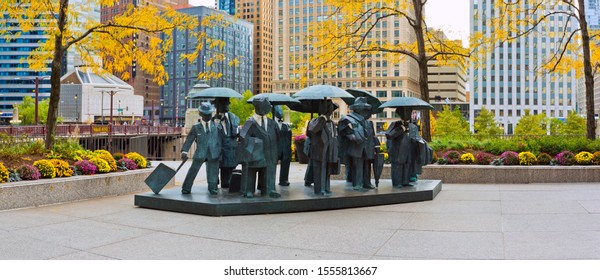 Chicago, USA - November 10, 2019: The Gentlemen Statues were created by Ju Ming and installed in 2015 in the AMA Plaza.