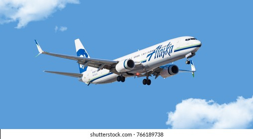 Chicago, USA - November 30, 2017: Alaska Airlines Boeing 737 aircraft on final approach at O'Hare International Airport.