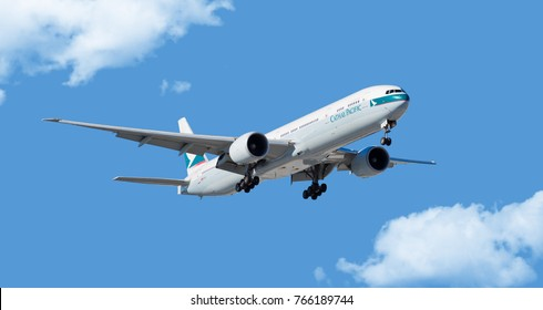 Chicago, USA - November 30, 2017: Cathay Pacific Airlines Boeing 777-300 aircraft on final approach at O'Hare International Airport. Cathay Pacific Airlines Limited is the flag carrier of Hong Kong.