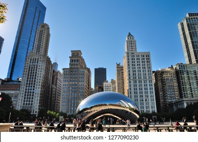 Chicago, USA - October 18, 2018 - Cloud Gate (The Bean) sculpture and Chicago skyline seen from the AT&T Plaza at Millennium Park in the Loop community area of Chicago, Illinois
