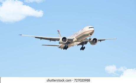 Chicago, USA - October 3, 2017: Chicago, USA - October 3, 2017: Etihad Airways Boeing 777-300ER wide-body passenger plane landing at O'Hare International Airport.