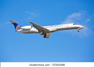 Chicago, USA - October 3, 2017: United Airlines Embraer ERJ-145 Aircraft on final approach at O'Hare International Airport.