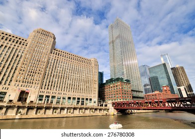 CHICAGO, USA - OCTOBER 6: Chicago Merchandise Mart and City buildings beside Chicago river in downtown of Chicago, Illinois, in October 6th, 2014.Chicago is the biggest city in North of USA.