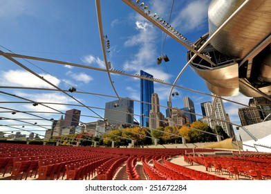 CHICAGO, USA - OCTOBER 6: Pritzker Pavilion in Millennium Park, and City buildings in downtown of Chicago, Illinois, in October 6th, 2014.Chicago is the biggest city in North of USA.