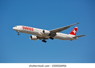 Chicago, USA - September 15, 2019: Swiss airline Boeing 777-300 on final approach to O'Hare International Airport. Swiss is the national airline of Switzerland.