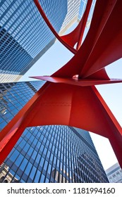 Chicago, USA - September 17, 2018: Red Flamingo sculpture, created by artist Alexander Calder in 1973, located in the Federal Plaza in Chicago, Illinois.