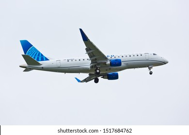 Chicago, USA - September 29, 2019: A United Airlines Embraer ERJ-170 aircraft displaying the new color scheme on final approach to O'Hare International Airport.