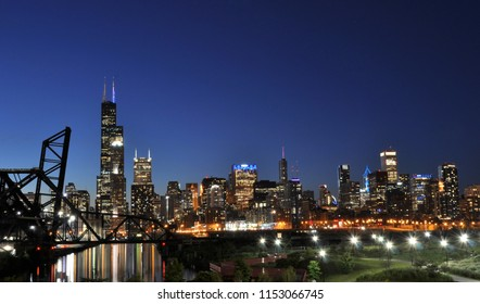Chicago USA-7-2-18: View of Chicago buildings taken from south side China town at dusk with reflection of building lights in the river. Bridge is open heading up. Sears (Willis) tower on the left.