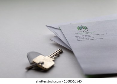 Chicago, USA-April 10, 2019: A mail piece or letter from Chicago Housing Authority CHA is displayed with a door key and key fob. Public housing assistance, Housing and Urban Development.