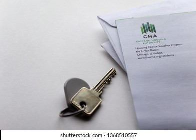 Chicago, USA-April 10, 2019: A mail letter from Chicago Housing Authority CHA is displayed with a door key and key fob. Public housing assistance program, HUD.