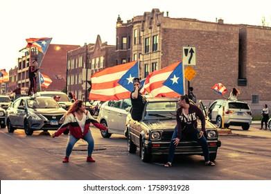 Chicago, USA-June 14, 2020: Girls twerking on cars in the Humboldt Park neighborhood to express Puerto Rican pride