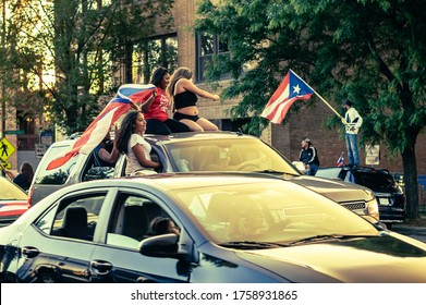 Chicago, USA-June 14, 2020: Hundreds of cars form a caravan in the Humboldt Park neighborhood to express Puerto Rican pride