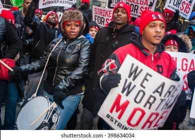 CHICAGO,ILLINOIS - December 4, 2014: Fast food, home health care, and other low-wage workers rally to advocate for the Fight For $15, which includes better wages and working conditions.