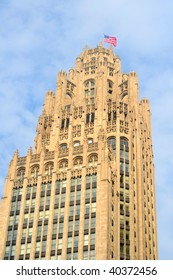 Chicago's old Tribune Tower with flag waving in the breeze