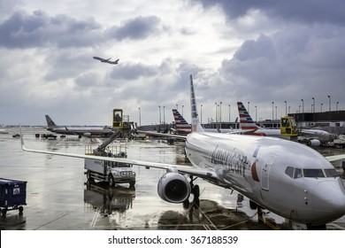 CHICAGO,UNITED STATES - JANUARY 22: Deicing of the American Airlines planes before take off on January 22, 2016 in Chicago. Deicing on O'Hare International Airport due to cold and snowy conditions.