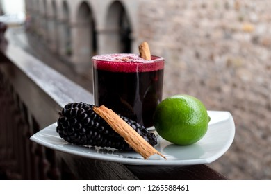 Chicha morada. Peruvian drink, decorated with lime, a piece of cinnamon and chicha fruit