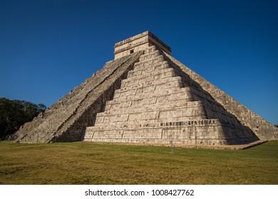 Chichen Itza - El Castillo Pyramid - Ancient Maya Temple Ruins in Mexico,  Quintana Roo, Yucatan. Mayan Pyramid near Cancun considered one of the seven wonders of the world.