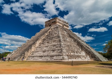 CHICHEN ITZA, MEXICO - FEB 26, 2016: Crowds of tourists visit the Kukulkan pyramid at the archeological site Chichen Itza.