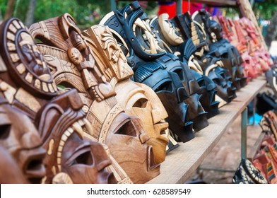 Chichen Itza, Mexico - February 23, 2016: Beautifully handicraft Maya masks souvenirs display at Chichen Itza archaeological site in Yucatan Peninsula,  Mexico.
