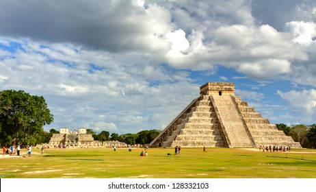 CHICHEN ITZA, MEXICO - JAN 28: crowded main pyramid on January 28, 2013 in Chichen Itza, Yucatan, Mexico. The temple of the warriors can be seen behind the main pyramid.