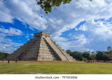 Chichen Itza / Mexico - January 28 2013: Tourists exploring the famous El Castillo  pyramid in Chichen Itza complex