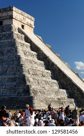 CHICHEN ITZA, MEXICO - MARCH 20: People from all over the world witness spring equinox with its famous shadow play at the Mayan temple to Kukulkan in Chichen Itza, Mexico, on March 20, 2012.