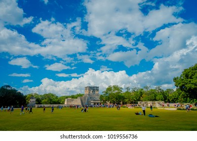 CHICHEN ITZA, MEXICO - NOVEMBER 12, 2017: Hundred of tourists enjoying the view in the temple of the Warriors in Chichen Itza, Quintana Roo, Mexico. Mayan, one of the most visited archaeological sites