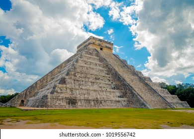 CHICHEN ITZA, MEXICO - NOVEMBER 12, 2017: Beautiful cloudy view of Chichen Itza, one of the most visited archaeological sites in Mexico. About 1.2 million tourists visit the ruins every year