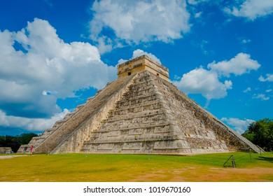 CHICHEN ITZA, MEXICO - NOVEMBER 12, 2017: Steps of the famous pyramid at Chichen Itza on the Yucatan Peninsula in Mexico with a gorgeous dar with blue sky an some cluds