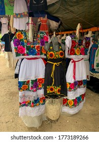 Chichen Itza, Yucatan / Mexico - December 29, 2019. Traditional Mexica colorful female clothes and dresses in the street shop on the souvenir market