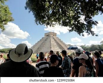 Chichen Itza/Mexico - November 28 2017: Crowd of Tourists at Chichen Itza Temple