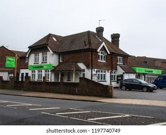 Chichester, United Kingdom - October 06 2018:   An Old house converted into a Co-Op Supermarket on Spitalfield Lane
