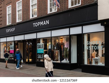 Chichester, United Kingdom - October 06 2018:   The Frontage of the TopMan and TopShop fashion store in North Street