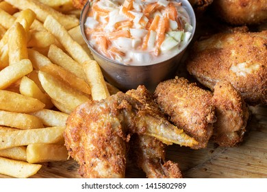"""Chicken """"a la broste"""" with chips and russian salad."""
