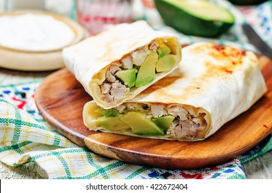 chicken avocado burritos. toning. selective focus