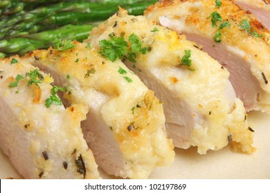 Chicken baked with cheese, lemon and herbs