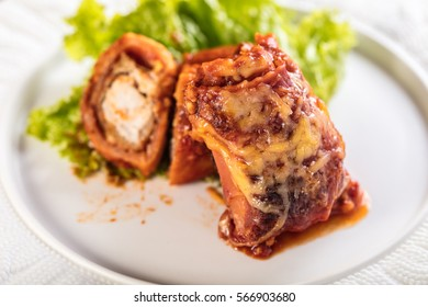 chicken baked in pastry with cheese and tomato sauce