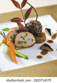 Chicken ballontine and sunflower seed chicken with shaved asparagus, carrot, mushroom infused with garlicky oyster sauce - Shutterstock ID 1823714579
