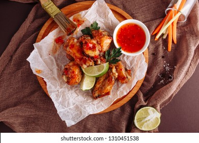Chicken Barbecue Buffalo Wing Top Down Flatlay. Bbq Dip Meat Food with Hot Spicy Sauce and Crispy Celery Stick. American Pub Roasted Appetizer with Lime and Carrot. Delicious Snack Cuisine