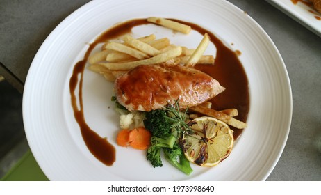chicken barbeque steak with vegetable and potato frenchfries